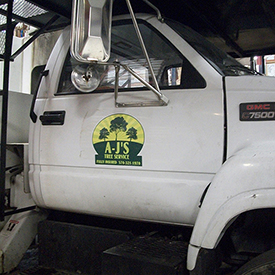 AJ's Tree Service cargo vehicle